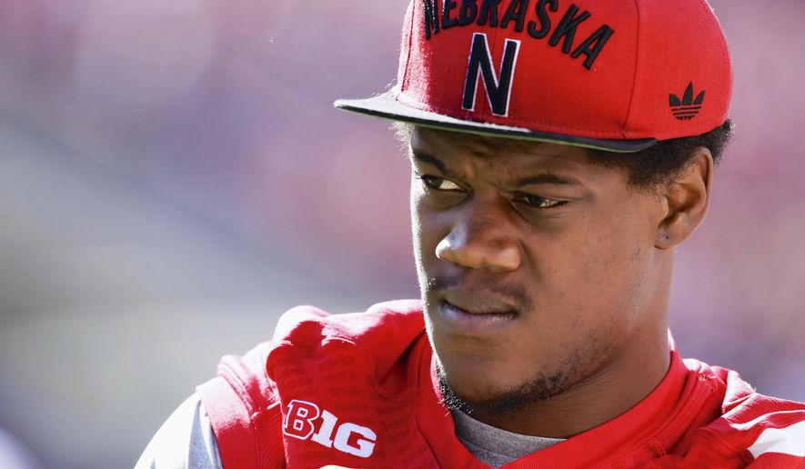 FILE - In a Sept. 6, 2014, file photo then-Nebraska defensive end Randy Gregory wears street clothes before an NCAA college football game against McNeese State in Lincoln, Neb. Randy Gregory says he's tested positive for marijuana at the NFL scouting combine last month and that he failed two drug tests at Nebraska last year. Gregory disclosed his marijuana use in an interview with NFL Media on Wednesday, March 25, 2015.  Gregory went into February's scouting combine projected to be among the top 10 picks  (AP Photo/Nati Harnik, File)