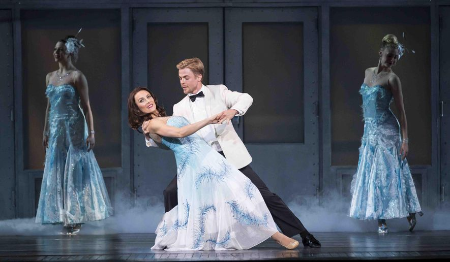 This March 10, 2015 photo provided by MSG Entertainment shows, Laura Benanti, left, and Derek Hough, in a rehearsal for the New York Spring Spectacular at Radio City Music Hall in N.Y. The show, which opened Thursday, March 26, 2015, at the 6,000-seat Radio City Music Hall, is more than a workout for the dancers - it's a nonstop, messy, cool, goofy, sloppy wet kiss to the city. (AP Photo/MSG Entertainment, Angela Cranford)