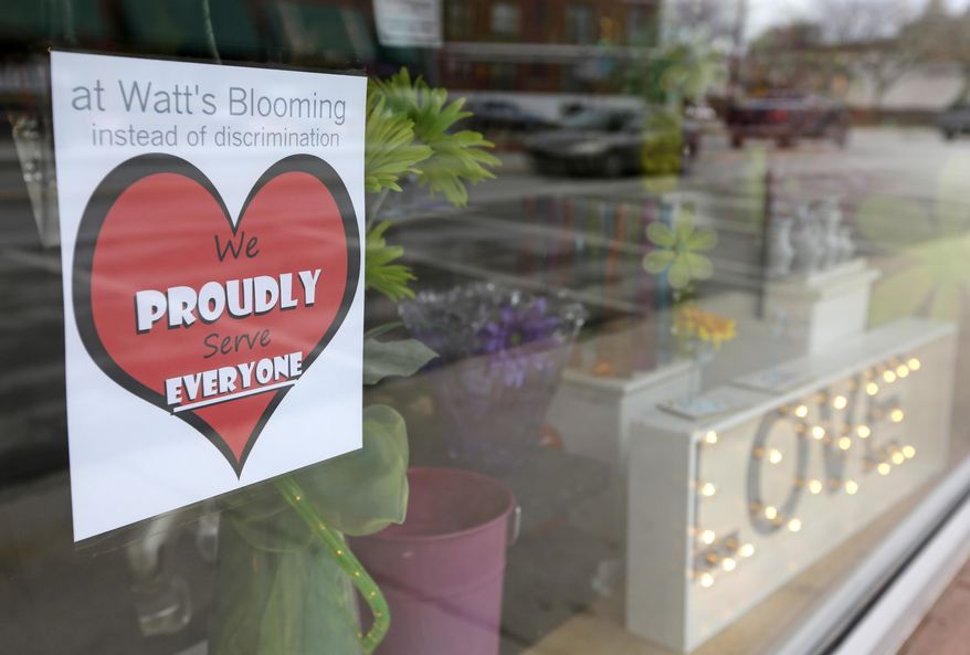A window sign on a downtown Indianapolis florist, Wednesday, March 25, 2015, shows it's objection to the Religious Freedom bill passed by the Indiana legislature. Organizers of a major gamers' convention and a large church gathering say they're considering moving events from Indianapolis over a bill that critics say could legalize discrimination against gays. (AP Photo/Michael Conroy) **FILE**