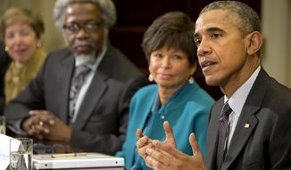 President Barack Obama sitting next to Senior Adviser Valerie Jarrett, and S. James Gates Jr., director of the Center for String and Particle Theory at the University of Maryland, College Park, talks about antibiotic-resistant bacteria as he meets with members of the his Council of Advisers on Science and Technology, Friday, March 27, 2015, in the Roosevelt Room of the White House in Washington. (AP Photo/Jacquelyn Martin) ** FILE **