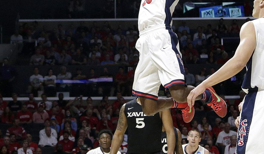Arizona forward Rondae Hollis-Jefferson dunks during the first half of a college basketball regional semifinal against Xavier in the NCAA Tournament, Thursday, March 26, 2015, in Los Angeles. (AP Photo/Jae C. Hong)