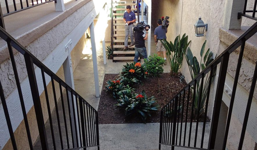 Members of the media gather Thursday, March 26, 2015, outside the apartment of Mike Huskins, father of Denise Huskins, where Denise Huskins, reported missing Monday from Vallejo, Calif., was found safe Wednesday in Huntington Beach, Calif. Denise Huskins' boyfriend had reported that intruders abducted her from their San Francisco Bay Area home and held her for ransom. Police said late Wednesday that Denise Huskins and Aaron Quinn concocted her reported abduction that spurred a two-day search. (AP Photo/Gillian Flaccus)
