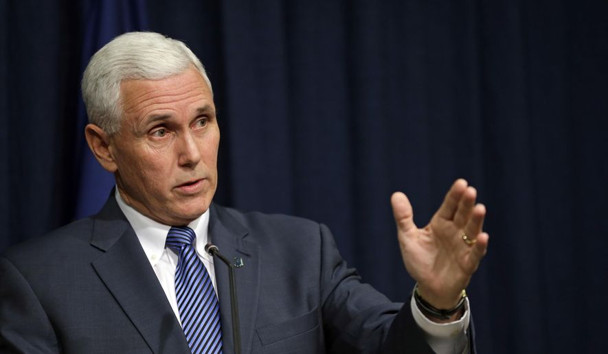 Indiana Gov. Mike Pence holds a news conference at the Statehouse in Indianapolis, Thursday, March 26, 2015. Pence has signed into law a religious objections bill that some convention organizers and business leaders have opposed amid concern it could allow discrimination against gay people. (AP Photo/Michael Conroy)
