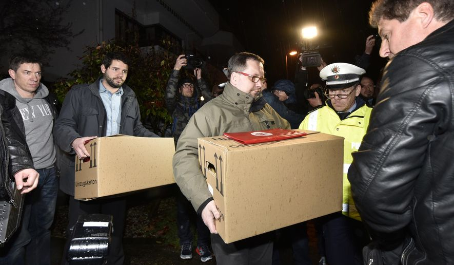 "Investigators carry boxes from the apartment of Germanwings airliner jet co-pilot Andreas Lubitz, in Duesseldorf, Germany, Thursday March 26, 2015. On Thursday, French prosecutors said Lubitz, the co-pilot of Germanwings Flight 9525, ""intentionally"" crashed the jet into the side of a mountain Tuesday in the French Alps. (AP Photo/Martin Meissner)"