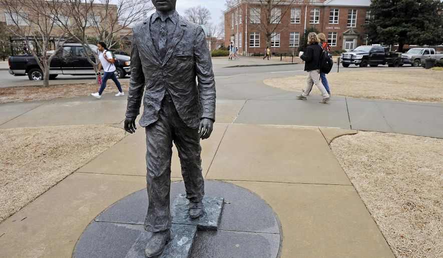 FILE - This Monday, Feb. 17, 2014 file photo shows the James Meredith statue on the University of Mississippi campus in Oxford, Miss. Graeme Phillip Harris of Alpharetta, Ga. has been indicted on federal civil rights charges connected to a noose being put on the statue of the student who integrated the university, the Justice Department said Friday, March 27, 2015. (AP Photo/The Daily Mississippian, Thomas Graning)
