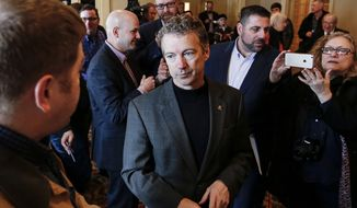 FILE - In this March 21, 2015 file photo, Sen. Rand Paul, Kentucky Republican, participates in a meet and greet at the Epoch Restaurant in Exeter, N.H. Few states have shaped presidential politics like Iowa, New Hampshire and South Carolina. By hosting the nation's first presidential primary contests, the states have reaped political and financial rewards for decades on successful candidates and hastened the end for underachievers. Yet their clout may be declining in 2016. (AP Photo/Cheryl Senter, File)
