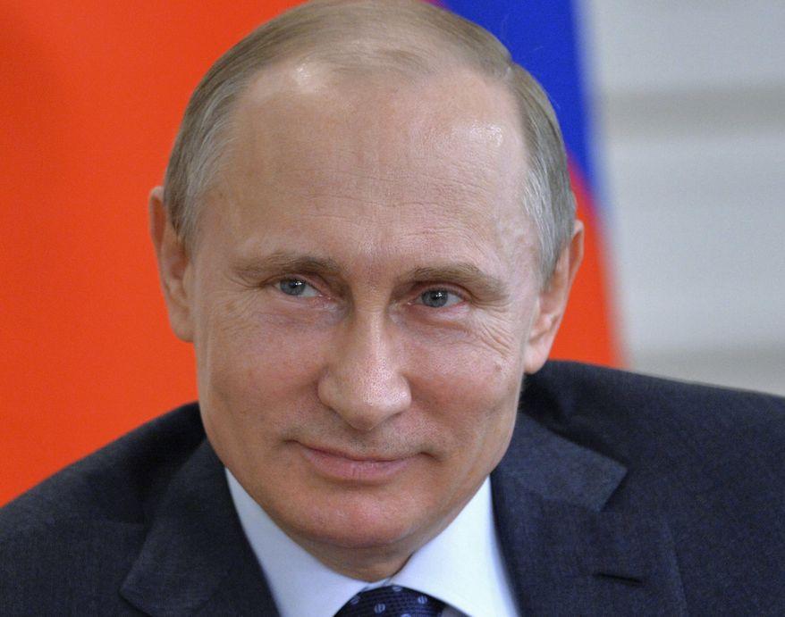Russian President Vladimir Putin smiles during a meeting on Internet startups in the Novo-Ogaryovo residence outside Moscow on March 27, 2015. (Associated Press/RIA-Novosti, Alexei Druzhinin, Presidential Press Service)  **FILE**