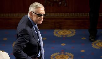 "FILE  In this March 25, 2015 file photo, Senate Minority Leader Harry Reid of Nev. waits on the floor of the House Capitol Hill in Washington for the arrival of Afghanistan's President Ashraf Ghani, who was to speak before  a joint meeting of Congress. Reid is announcing he will not seek re-election to another term. The 75-year-old Reid says in a statement issued by his office Friday that he wants to make sure Democrats regain control of the Senate next year and that it would be ""inappropriate"" for him to soak up campaign resources when he could be focusing on putting the Democrats back in power. (AP Photo/Pablo Martinez Monsivais, File)"