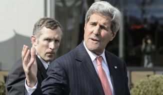 U.S. Secretary of State John Kerry walks outside the hotel during a break after a bilateral meeting with Iranian Foreign Minister Mohammad Javad Zarif for a new round of Nuclear Talks with Iran, in Lausanne, Switzerland, Friday, March 27, 2015. (AP Photo/Keystone,Jean-Christophe Bott)