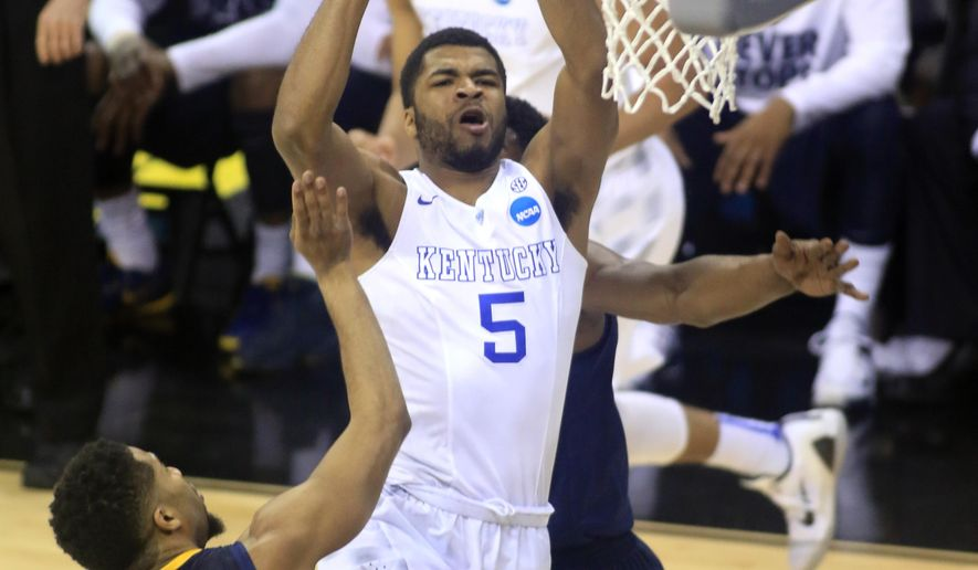 Kentucky's Andrew Harrison (5) shoots against West Virginia during the first half of a college basketball game in the NCAA men's tournament regional semifinals, Thursday, March 26, 2015, in Cleveland. (AP Photo/Aaron Josefczyk)