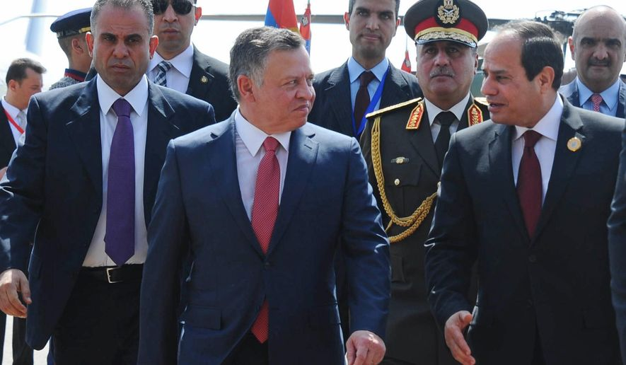"""Egyptian President Abdel Fattah al-Sisi, right, greets Jordan's King Abdullah II on his arrival to attend an Arab summit, in Sharm el-Sheikh, South Sinai, Egypt, Saturday, March 28, 2015. In a speech to Arab leaders, Yemen's embattled president on Saturday called Shiite rebels who forced him to flee the country """"puppets of Iran,"""" directly blaming the Islamic Republic for the chaos there and demanding airstrikes against rebel positions continue until they surrender. (AP Photo/MENA)"""