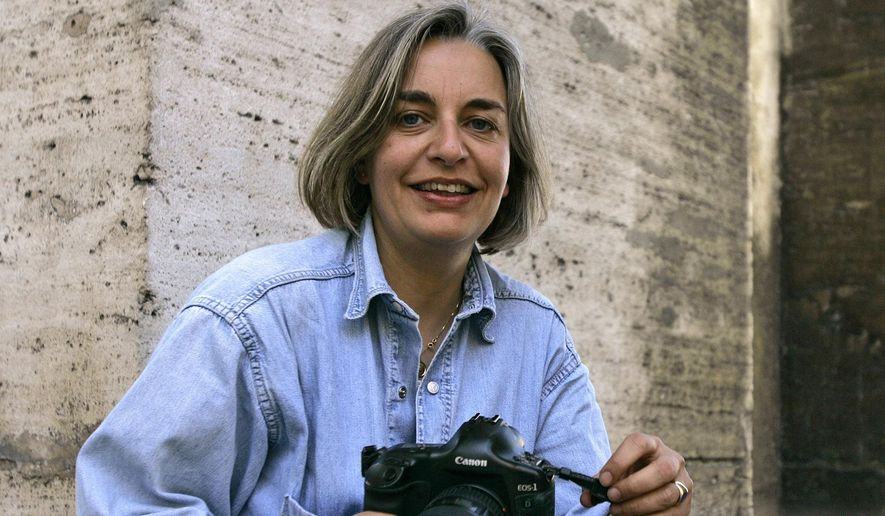 FILE - In this April 7, 2005 file photo, Associated Press photographer Anja Niedringhaus poses in Rome.  Afghanistan's highest court has ruled that the police officer convicted of murdering Niedringhaus and wounding AP correspondent Kathy Gannon almost one year ago should serve 20 years in prison, according to documents sent to the country's attorney general on Saturday, March 28, 2015.  The final sentence for former Afghan police unit commander Naqibullah was reduced from the death penalty recommended by a primary court last year. Twenty years in prison is the maximum jail sentence in Afghanistan, said Zahid Safi, a lawyer for The Associated Press who had been briefed on the decision by the Supreme Court.  (AP Photo/Peter Dejong, File)