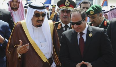 In this photo provided by Egypt's state news agency MENA, Egyptian President Abdel-Fattah el-Sissi, right, talks with Saudi King Salman after the king arrived in Sharm el-Sheikh, Egypt, Saturday, March 28, 2015. El-Sissi later made the remarks at the opening session of an Arab summit held in Egypt's Red Sea resort of Sharm el-Sheikh. (AP Photo/MENA) (AP Photo/MENA)