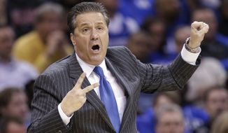 Kentucky coach John Calipari signals to his team during the first half of a college basketball game against Notre Dame in the NCAA men's tournament regional finals, Saturday, March 28, 2015, in Cleveland. (AP Photo/Tony Dejak)