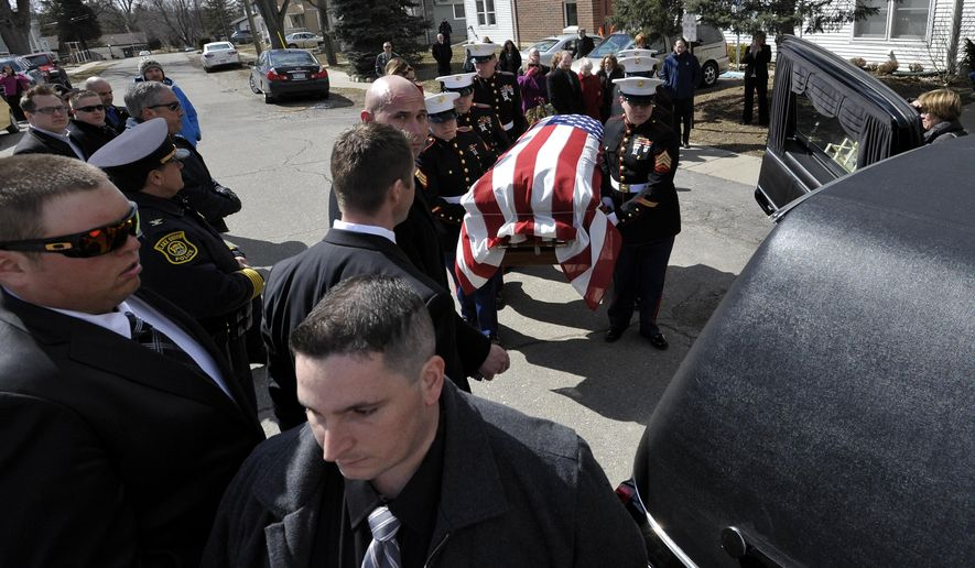 U.S. Marines carry the casket of Staff Sgt. Trevor P. Blaylock, 29, to a hearse outside the Lake Orion United Methodist church in Lake Orion, Mich. on Saturday, March 28, 2015. Blaylock was among seven Marines and four Army soldiers killed when their helicopter crashed in dense fog along Florida's Panhandle on March 10. (AP Photo/The Detroit News, Todd McInturf)