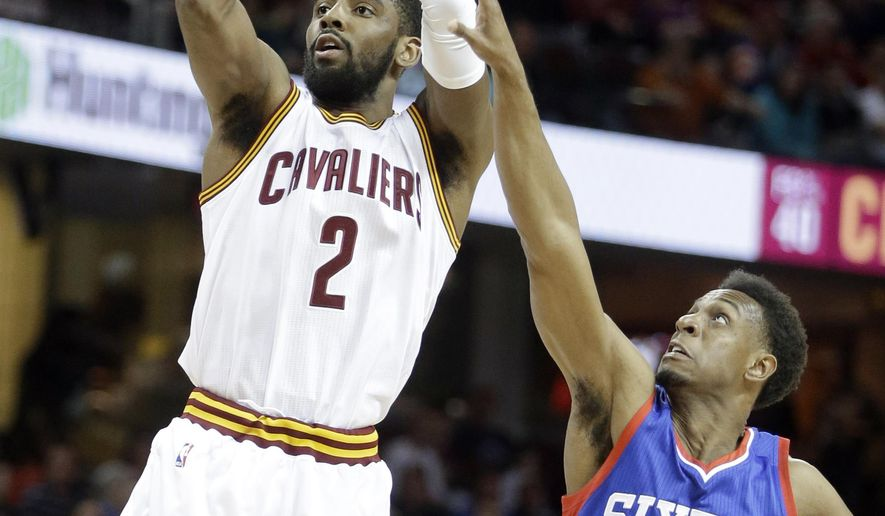 Cleveland Cavaliers' Kyrie Irving (2) shoots against Philadelphia 76ers' Ish Smith (5) in the first quarter of an NBA basketball game Sunday, March 29, 2015, in Cleveland. (AP Photo/Mark Duncan)