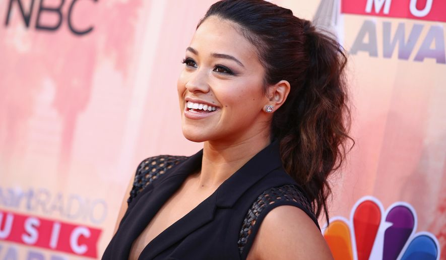 Gina Rodriguez arrives at the iHeartRadio Music Awards at The Shrine Auditorium on Sunday, March 29, 2015, in Los Angeles. (Photo by John Salangsang/Invision/AP)