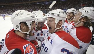 Washington Capitals left wing Jason Chimera (25) celebrates with teammates after scoring against New York Rangers goalie Cam Talbot during the third period of an NHL hockey game, Sunday, March 29, 2015, in New York. The Capitals won 5-2. (AP Photo/John Minchillo)