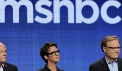 "Phil Griffin, left, president of MSNBC, Rachel Maddow, center, host of ""The Rachel Maddow Show,"" and Lawrence O'Donnell, host of ""The Last Word,"" take part in a panel discussion on the show at the NBCUniversal summer press tour, in Beverly Hills, Calif. (AP Photo/Chris Pizzello, File)"