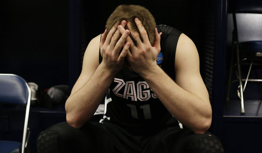 Gonzaga's Domantas Sabonis holds his head down by his locker after a college basketball regional final game against Duke in the NCAA Tournament Sunday, March 29, 2015, in Houston. Duke won 66-52 to advance to the Final Four. (AP Photo/Charlie Riedel)