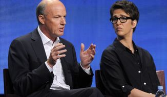 """FILE - In this Aug. 2, 2011 file photo, Phil Griffin, left, president of MSNBC, answers a question as Rachel Maddow, host of """"The Rachel Maddow Show,"""" looks on at the NBC Universal summer press tour, in Beverly Hills, Calif. Griffin has lately sought to broaden MSNBC's outlook by taking on a greater variety of stories, even hiring a food correspondent, and there's been some uptick in the ratings the past few weeks. He changed the daytime lineup, ditching opinionated programs hosted by Ronan Farrow and Joy-Ann Reid and establishing a news-focused bloc with Jose Diaz-Balart, Andrea Mitchell and Thomas Roberts. (AP Photo/Chris Pizzello, File)"""