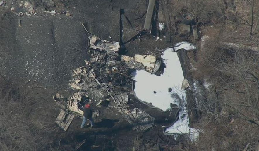 This aerial image made from a video provided by NBC10 shows the scene of a small plane crash in Chester County, Pa., near the Brandywine airport, Sunday, March 29, 2015. The crash took the lives of the only two people aboard the aircraft, authorities said. (AP Photo/NBC10)