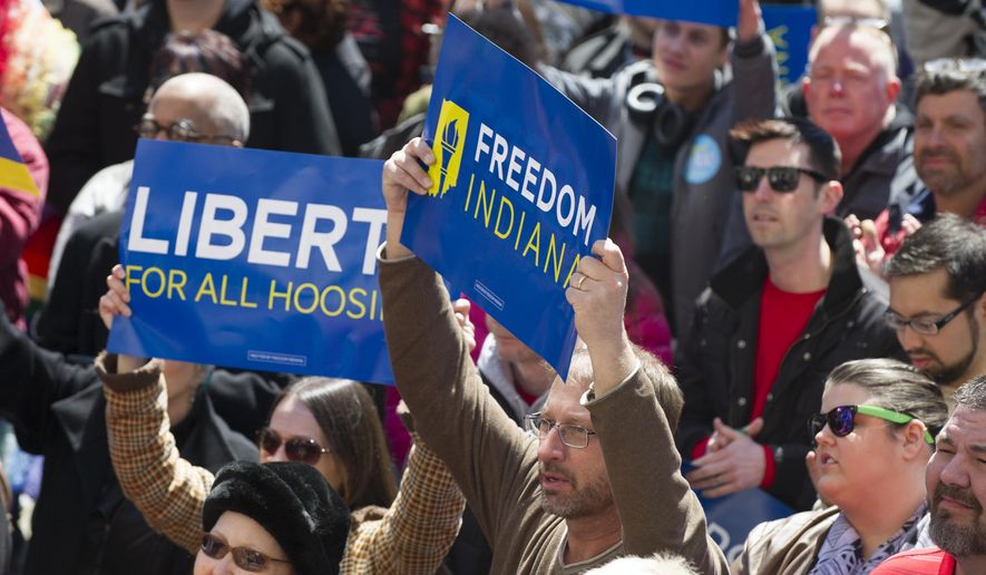 """Thousands of opponents of Indiana Senate Bill 101, the Religious Freedom Restoration Act, gathered on the lawn of the Indiana State House to rally against that legislation Saturday, March 28, 2015.  Republican Gov. Mike Pence signed a bill Thursday prohibiting state laws that """"substantially burden"""" a person's ability to follow his or her religious beliefs. (AP Photo/Doug McSchooler)"""