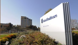This Tuesday, Oct. 16, 2012, file photo, shows a portion of The UnitedHealth Group Inc.'s  campus in Minnetonka, Minn. (AP Photo/Jim Mone, File)