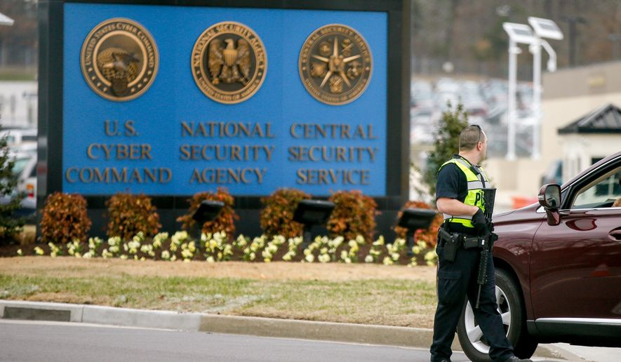 A police officer stands at a gate to Fort Meade directing a vehicle to turn away after a vehicle rammed a gate to the National Security Agency, Monday, March 30, 2015 in Fort Meade, Md. One person was killed in a firefight that erupted Monday after a car with two people tried to ram a gate at the Fort Meade, Md., military base near a gate to the National Security Agency, according to preliminary reports cited by two U.S. officials.  (AP Photo/Andrew Harnik)