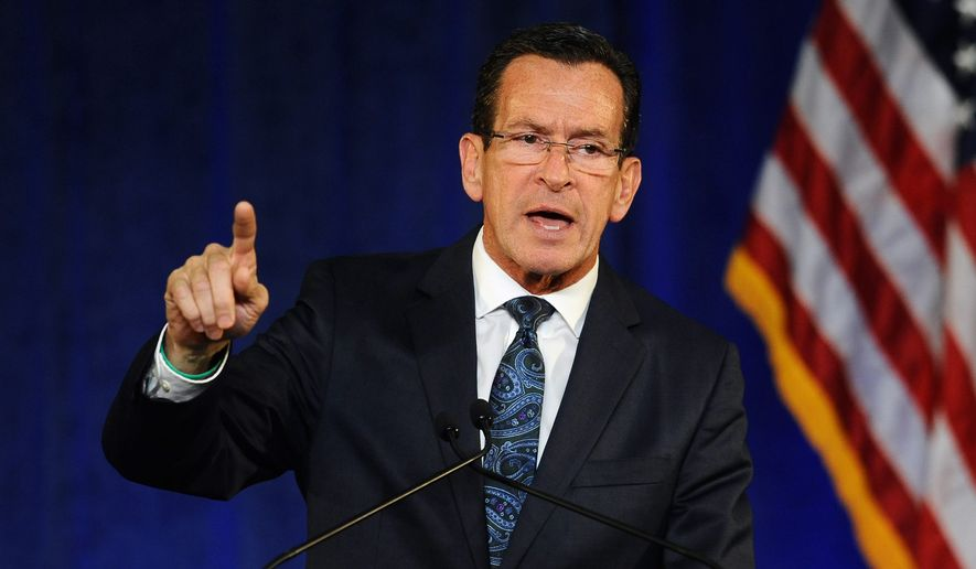Connecticut Gov. Dan. Malloy, whose state has its own religious freedom law, announced Monday that he would sign a ban on state-funded travel to Indiana in response to that state's enactment last week of the Religious Freedom Restoration Act. (Associated Press)