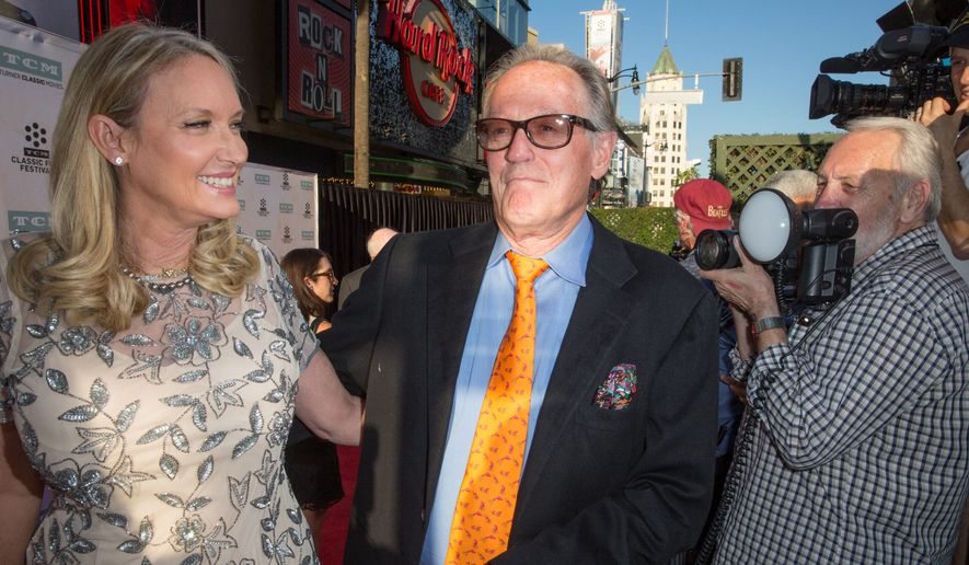 "Parky Fonda, left, and Peter Fonda arrive at the 2015 TCM Classic Film Festival Opening Night Gala ""The Sound Of Music"" at TCL Chinese Theatre on Thursday, March 26, 2015, in Los Angeles. (Associated Press) ** FILE **"