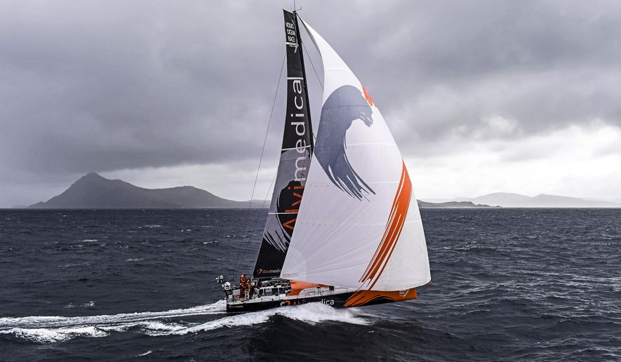In this photo provided by the Team Alvimedica, the joint American-Turkish Team Alvimedica, led by American skipper Charlie Enright, rounds Cape Horn, seen in background at the southern tip of South America, holding a 15-minute lead over co-leader Abu Dhabi Ocean Racing, in the Volvo Ocean Race Monday, March 30, 2015. (AP Photo/Team Alvimedica, Rick Tomlinson)