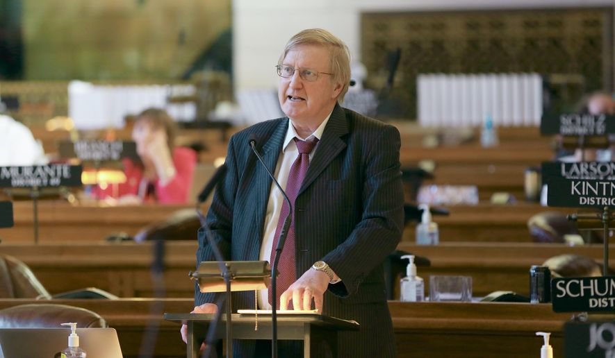 Sen. Paul Schumacher of Columbus speaks in the Legislative Chamber in Lincoln, Neb., Monday, March 30, 2015, on a ballot measure he introduced that could give Nebraska lawmakers an extra four years in office. Senators gave the constitutional amendment proposal first-round approval with a 27-12 vote. It would allow lawmakers to serve up to three consecutive four-year terms in office, if voters approve it. (AP Photo/Nati Harnik)