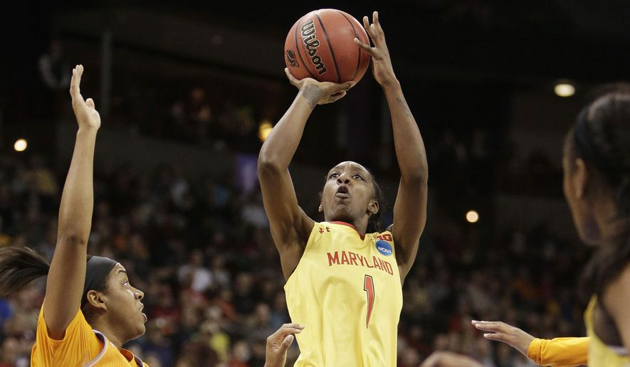 Maryland's Laurin Mincy (1) shoots against Tennessee's Ariel Massengale (5) during a women's college basketball regional final game in the NCAA tournament, Monday, March 30, 2015, in Spokane, Wash. (AP Photo/Young Kwak)