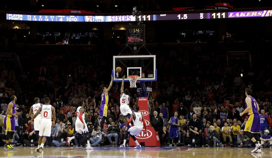 Los Angeles Lakers' Jordan Clarkson (6) shoots the game-winning basket over Philadelphia 76ers' Ish Smith (5) during the final seconds of overtime in an NBA basketball game, Monday, March 30, 2015, in Philadelphia. Los Angeles won 113-111. (AP Photo/Matt Slocum)