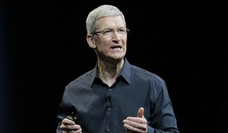 """Apple CEO Tim Cook speaks at the Apple Worldwide Developers Conference event in San Francisco in this June 2, 2014, file photo. Cook says that so-called """"religious objection"""" legislation being introduced in a number states like Indiana and Texas is dangerous. In an op-ed piece for The Washington Post, Cook said that the bills under consideration """"have the potential to undo decades of progress toward greater equality."""" (AP Photo/Jeff Chiu, File)"""