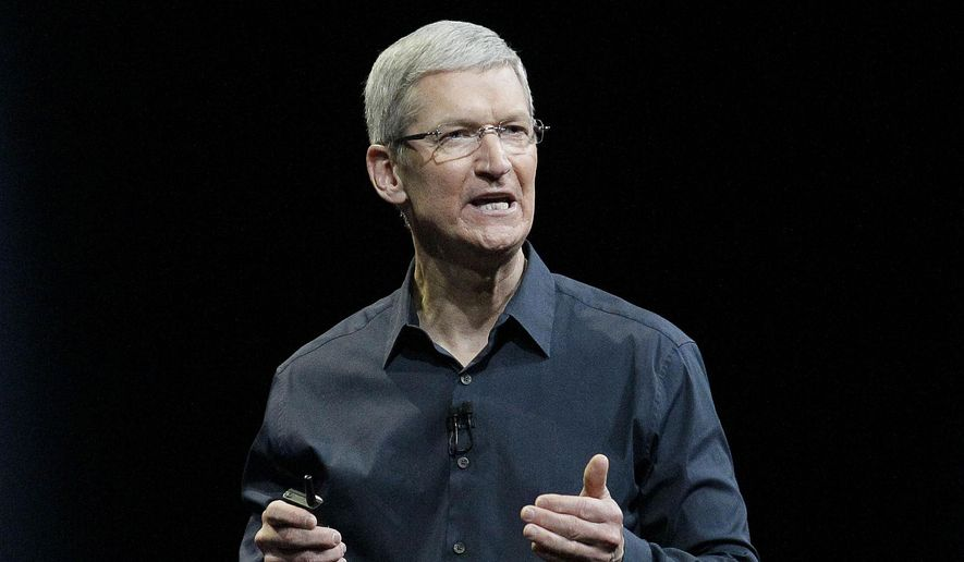 "Apple CEO Tim Cook speaks at the Apple Worldwide Developers Conference event in San Francisco in this June 2, 2014, file photo. Cook says that so-called ""religious objection"" legislation being introduced in a number states like Indiana and Texas is dangerous. In an op-ed piece for The Washington Post, Cook said that the bills under consideration ""have the potential to undo decades of progress toward greater equality."" (AP Photo/Jeff Chiu, File)"
