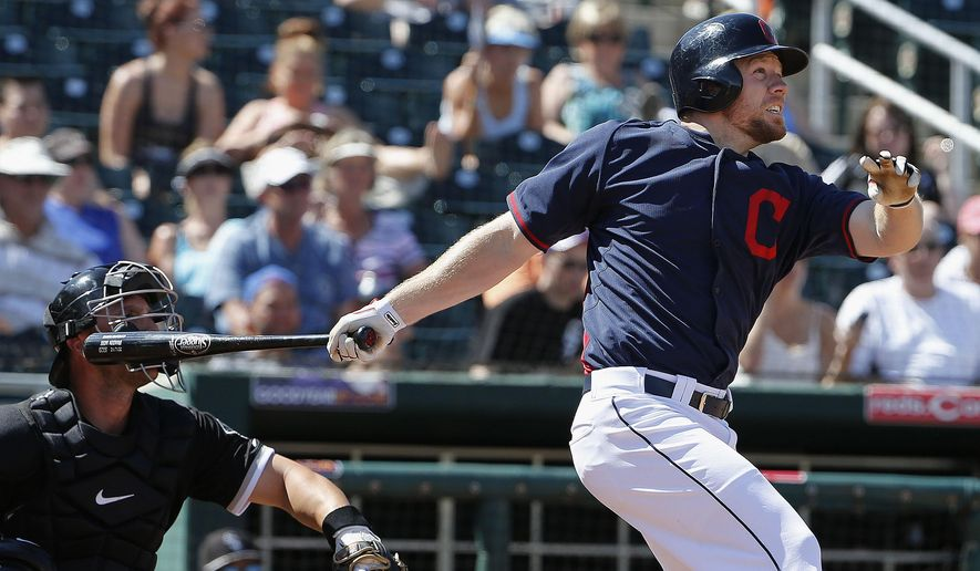 Cleveland Indians' Brandon Moss connects for a double against the Chicago White Sox during the fifth inning of a spring training baseball game Sunday, March 29, 2015, in Goodyear, Ariz.  The White Sox defeated the Indians 4-1. (AP Photo/Ross D. Franklin)