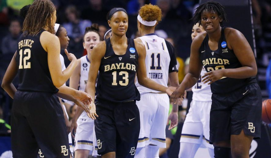 Baylor forward Nina Davis (13) reacts with guard Alexis Prince (12) and forward Sune Agbuke (22) during the second half of a women's college basketball regional final game against Notre Dame in the NCAA Tournament, Sunday, March 29, 2015, in Oklahoma City. (AP Photo/Sue Ogrocki)