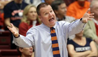 Bucknell coach Dave Paulsen talks to his players during the first half of an NCAA college basketball game against Stanford on Friday, Nov. 8, 2013, in Stanford, Calif. (AP Photo/Marcio Jose Sanchez)