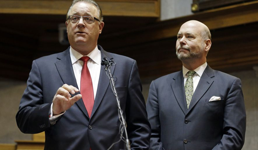 Indiana Senate President Pro Tem David Long, left, R-Fort Wayne, and House Speaker Brian C. Bosma R-Indianapolis, discuss their plans for clarifying the Indiana Religious Freedom Restoration Act during a news conference at the Statehouse in Indianapolis, Monday, March 30, 2015. Republican legislative leaders in Indiana state say they are working on adding language to a new state law to make it clear that it doesn't allow discrimination against gays and lesbians. (AP Photo/Michael Conroy)