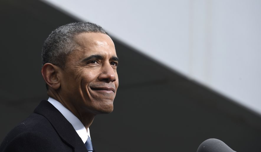 President Barack Obama pauses while speaking at the dedication of the Edward M. Kennedy Institute for the United States Senate, Monday, March 30, 2015, in Boston. The $79 million Edward M. Kennedy Institute for the United States Senate dedication is a politically star-studded event attended by President Barack Obama, Vice President Joe Biden and past and present senators of both parties. It sits next to the presidential library of Kennedy's brother, John F. Kennedy. (AP Photo/Susan Walsh)