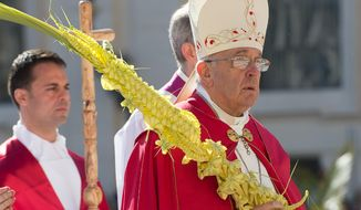 In this March 29, 2015 pool photo, Pope Francis celebrates a Palm Sunday Mass in St. Peter's Square, at the Vatican. Pope Francis has walked solemnly through St. Peter's Square in a Palm Sunday procession to usher in Holy Week ahead of Easter. Francis clutched a palm frond for the religious service, celebrated outside St. Peter's Basilica. (AP Photo/L'Osservatore Romano, Pool)