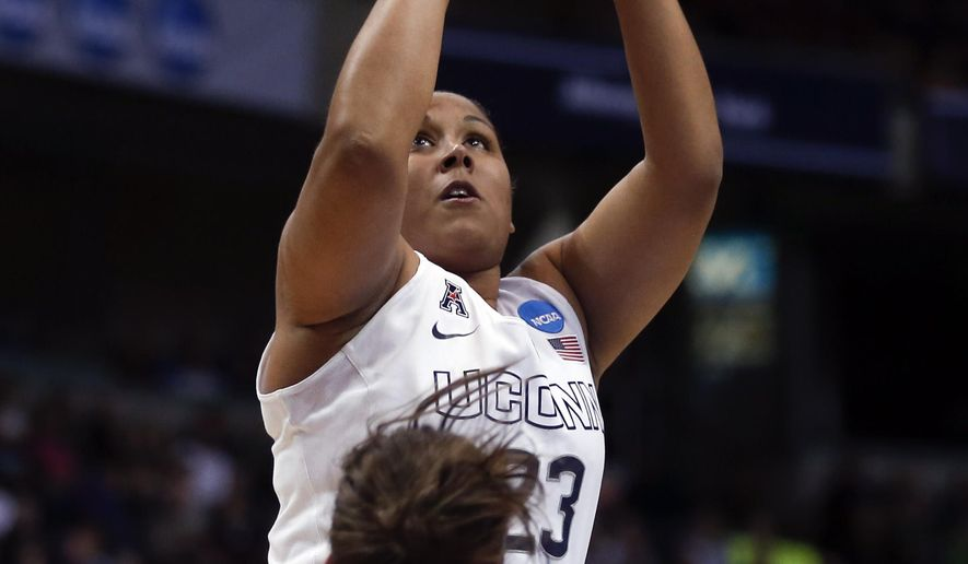 Connecticut forward Kaleena Mosqueda-Lewis (23) shoots over Dayton guard Andrea Hoover (24) during the first half of a regional final game in the NCAA women's college basketball tournament Monday, March 30, 2015, in Albany, N.Y. (AP Photo/Mike Groll)
