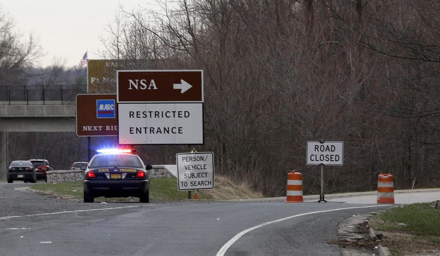 A Maryland State Police cruiser sits at a blocked southbound entrance on the Baltimore-Washington Parkway that accesses the National Security Agency, Monday, March 30, 2015, in Fort Meade, Md. A spokeswoman at Fort Meade says two people have been injured near a gate to the NSA. (AP Photo/Patrick Semansky)