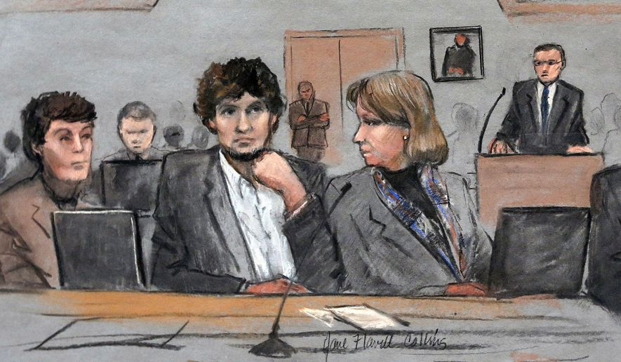 Dzhokhar Tsarnaev, center, is depicted between defense attorneys Miriam Conrad, left, and Judy Clarke, right, during his federal death penalty trial in Boston in this March 5, 2015, file photo. (AP Photo/Jane Flavell Collins, File)