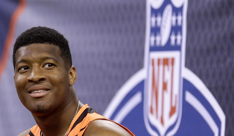FILE - This is a Feb. 21, 2015, file photo showing Jameis Winston at the NFL football scouting combine in Indianapolis. Winston has spent much of the past two months crisscrossing the nation, sharpening his quarterback skills and trying to convince NFL teams he's learned from mistakes made off the field and ready to become the face of a franchise. (AP Photo/David J. Phillip, File)