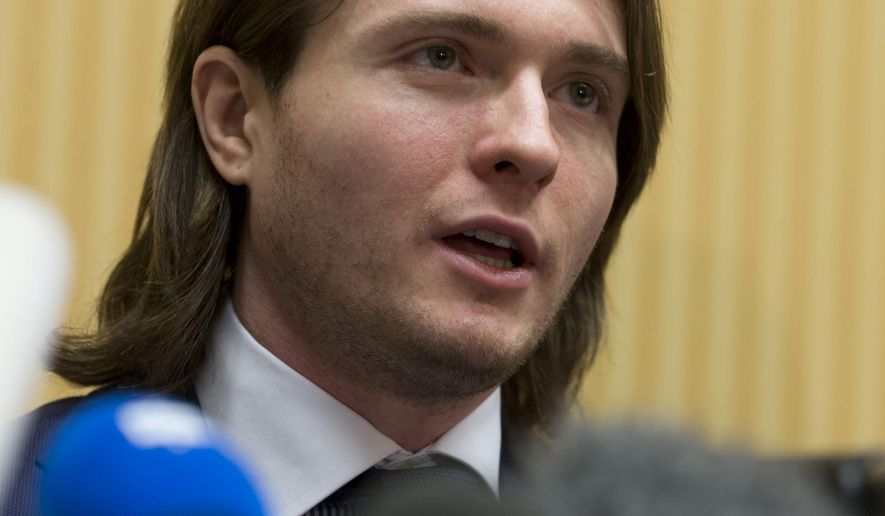 Raffaele Sollecito talks to the media during a press conference in Rome, Monday, March 30, 2015. Amanda Knox, who maintained that she and her former Italian boyfriend Raffaele Sollecito were innocent in her British roommate's murder through multiple trials and nearly four years in jail, was vindicated Friday when Italy's highest court threw out their convictions once and for all. (AP Photo/Andrew Medichini)