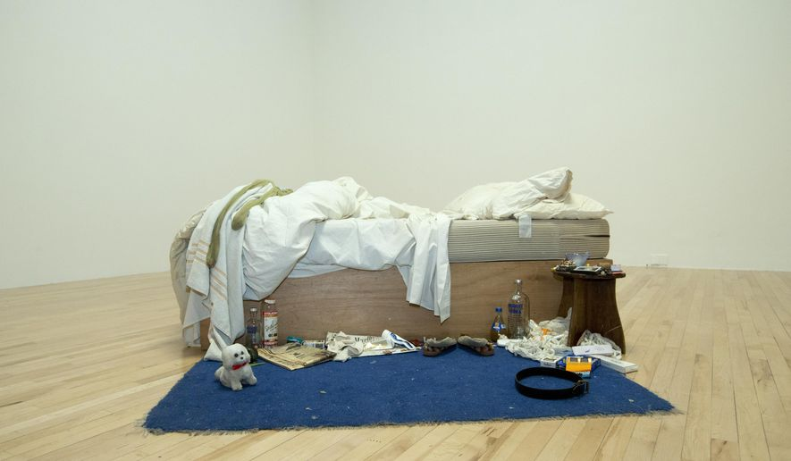 A general view of British artist Tracey Emin's work entitled 'My Bed' as the gallery highlights new and rehung works of art at the Tate Britain gallery in London, Monday, March 30, 2015. Emin's bed was originally showcased at the gallery some 15 year ago. (AP Photo/Alastair Grant)