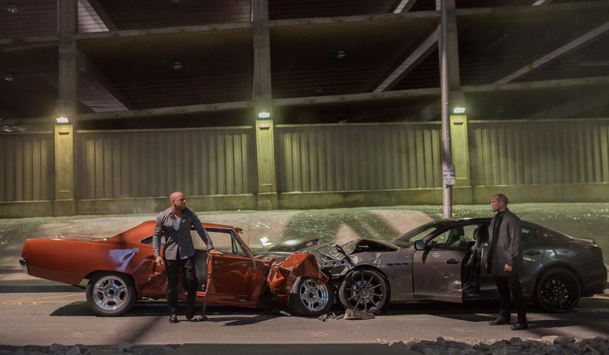 "This photo provided by Universal Pictures shows, Vin Diesel, left, as Dom Toretto, and Jason Statham as Deckard Shaw, in a scene from ""Furious 7.""  (AP Photo/Universal Pictures, Scott Garfield)"